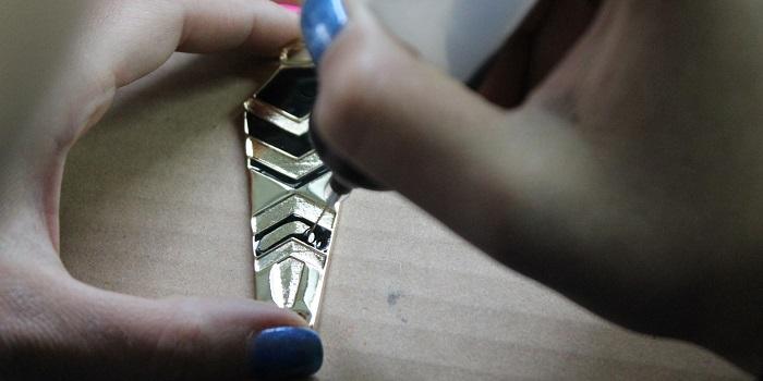 produzione componenti metalliche moda